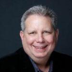 Mike Flathers geht zu Signiant